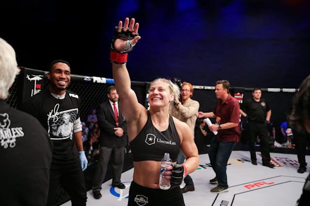 """<a class=""""link rapid-noclick-resp"""" href=""""/olympics/rio-2016/a/1160667/"""" data-ylk=""""slk:Kayla Harrison"""">Kayla Harrison</a> waves to the crowd after her win at PFL 2 on June 21, 2018 at the Chicago Theatre in Chicago. (Photo courtesy Ryan Loco)"""