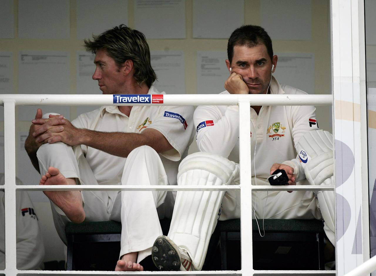 LONDON - SEPTEMBER 09:  Glenn McGrath and Justin Langer of Australia look on from the balcony after bad light stopped play during day two of the Fifth npower Ashes Test match between England and Australia at the Brit Oval on September 9, 2005 in London, England.  (Photo by Tom Shaw/Getty Images)