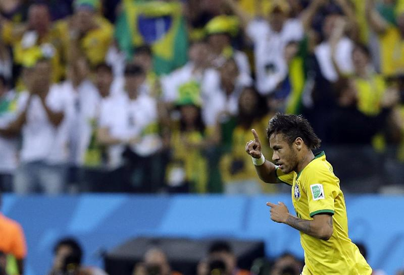Brazil's Neymar celebrates after scoring during the group A World Cup soccer match between Brazil and Croatia, the opening game of the tournament, in the Itaquerao Stadium in Sao Paulo, Brazil, Thursday, June 12, 2014