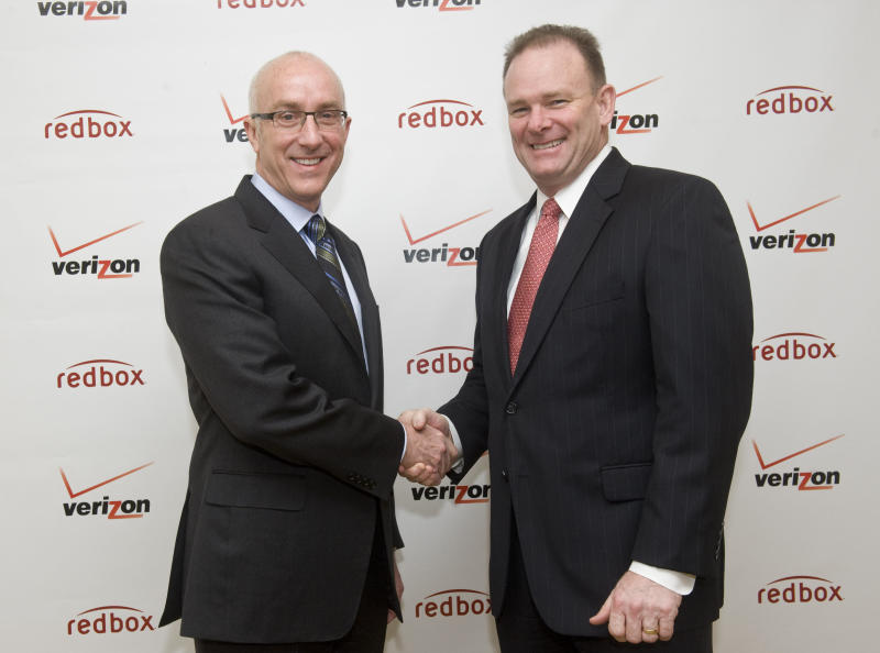 COMMERCIAL IMAGE - In this photograph taken by AP Images for Redbox, Bob Mudge, right, president of Verizon Consumer and Mass Business Markets, and Paul Davis, CEO of Coinstar, Inc. announced today, Monday, Feb. 6, 2012, in New York, a joint venture that delivers a combination of Redbox entertainment options with an on-demand streaming service from Verizon, Inc. Redbox Automated Retail, LLC is a wholly-owned subsidiary of Coinstar, Inc. (Diane Bondareff/AP Images for Redbox)
