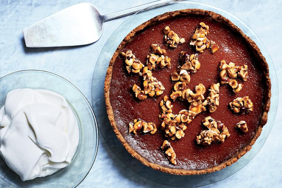 """We know, we said no pies, but this is a tart and that's technically <a href=""""https://www.masterclass.com/articles/pastry-fundamentals-whats-the-difference-between-pies-and-tarts"""" rel=""""nofollow noopener"""" target=""""_blank"""" data-ylk=""""slk:not the same thing"""" class=""""link rapid-noclick-resp"""">not the same thing</a>. This one has a creamy spiced pumpkin filling set between a hazelnut crust and brittle-like candied hazelnuts. <a href=""""https://www.epicurious.com/recipes/food/views/pumpkin-caramel-tart-with-toasted-hazelnut-crust?mbid=synd_yahoo_rss"""" rel=""""nofollow noopener"""" target=""""_blank"""" data-ylk=""""slk:See recipe."""" class=""""link rapid-noclick-resp"""">See recipe.</a>"""