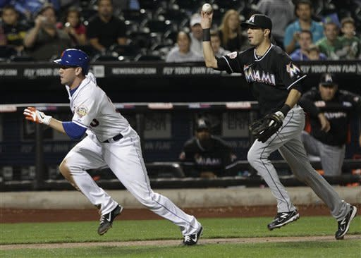 Miami Marlins shortstop Gil Velazquez, right, runs down New York Mets' Josh Thole during the second inning of a baseball game on Friday, Sept. 21, 2012, in New York. Thole was out on the play. (AP Photo/Frank Franklin II)