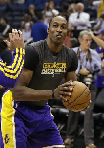 Los Angeles Lakers' Dwight Howard warms up prior to an NBA basketball game against the Orlando Magic, Tuesday, March 12, 2013, in Orlando, Fla. (AP Photo/John Raoux)