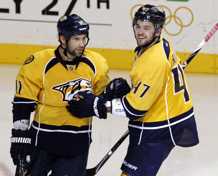 Nashville Predators center David Legwand (11) celebrates with Alexander Radulov (47), of Russia, after scoring against the Detroit Red Wings in the third period of Game 5 of a first-round NHL Stanley Cup hockey playoff series on Friday, April 20, 2012, in Nashville, Tenn. Radulov scored in the first period, and Legwand's score in the third period gave the Predators a 2-1 win. They won the series 4-1. (AP Photo/Mark Humphrey)