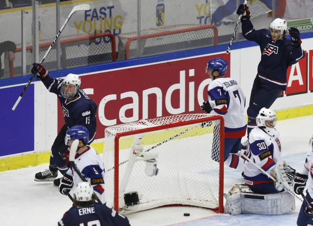 Jack Eichel (L) and Brady Skjei of the U.S. celebrate after scoring a goal against Slovakia's goalie Richard Sabol and Jakub Predajniansky (2R) during the first period of their IIHF World Junior Championship ice hockey game in Malmo, Sweden, December 28, 2013. REUTERS/Alexander Demianchuk (SWEDEN - Tags: SPORT ICE HOCKEY)