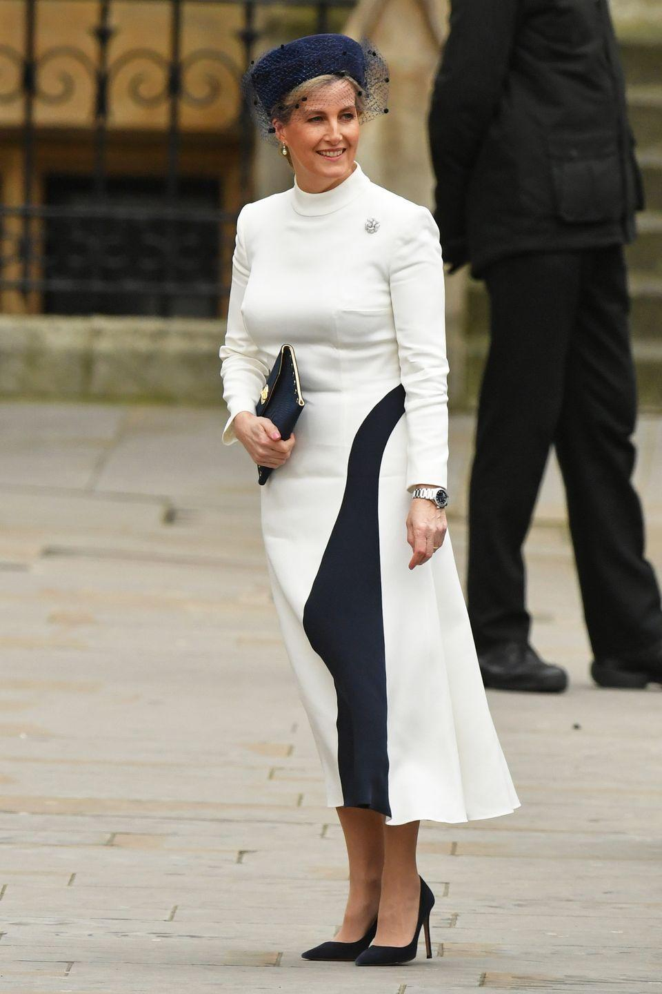 <p>For this year's Commonwealth Day Service at Westminster Abbey, the Countess of Wessex chose a cream dress with a navy design, a look which she paired wiht a bold blue had, small clutch, and pointy-toed shoes.</p>