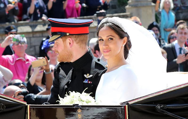 Prince Harry, Duke of Sussex and the Duchess of Sussex in the Ascot Landau carriage during the procession after getting married at St George's Chapel, Windsor Castle on May 19, 2018 in Windsor, England. (Photo: WPA Pool via Getty Images)