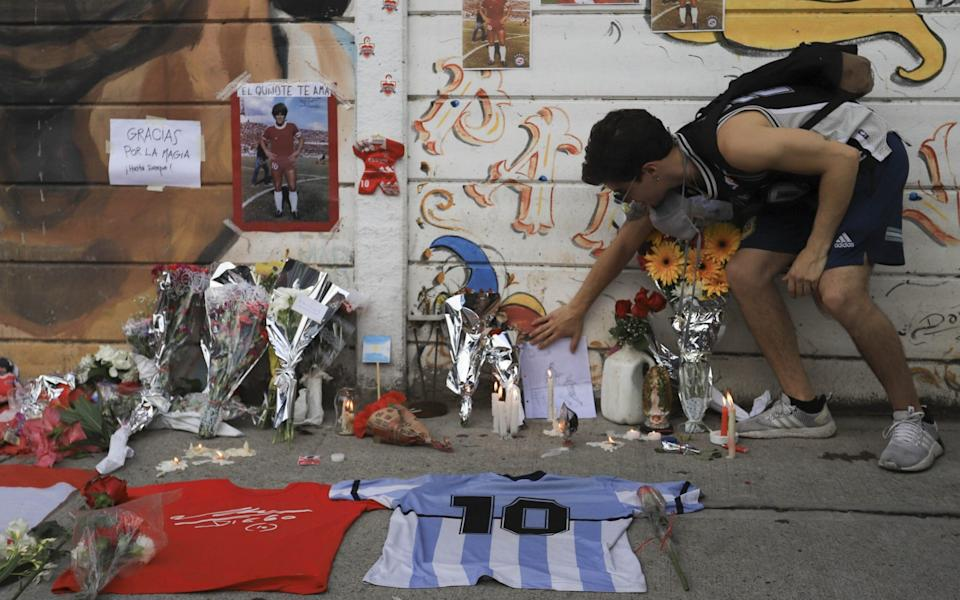A large number of supporters pay tribute to Diego Maradona in front of the Argentinos Jrs stadium