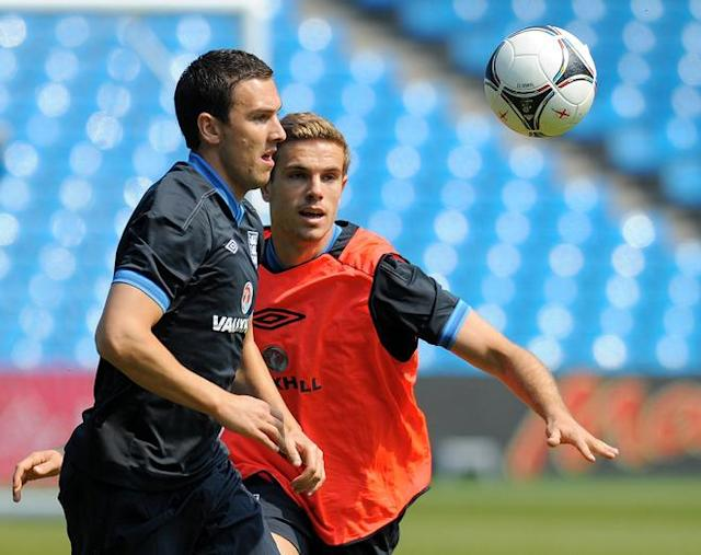 Englands's Stewart Downing (L) and Jordan Henderson vie for the ball during a training session at The Etihad stadium in Manchester, north-west England on May 24, 2012 ahead of their international friendly football match against Norway in Oslo on Saturday May 26. AFP PHOTO/ANDREW YATES. NOT FOR MARKETING OR ADVERTISING USE/RESTRICTED TO EDITORIAL USEANDREW YATES/AFP/GettyImages