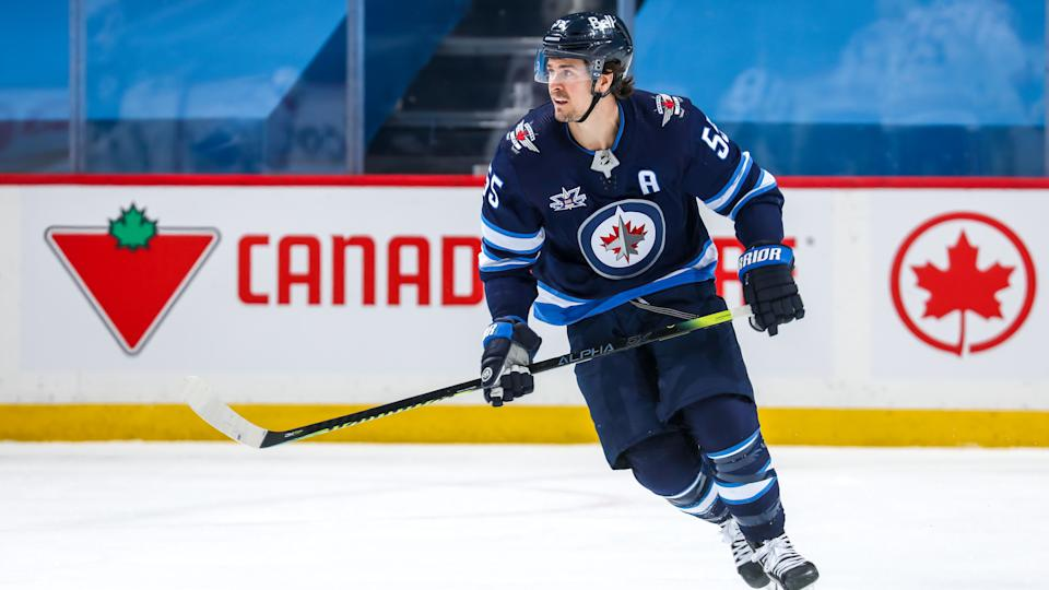 WINNIPEG, MB - FEBRUARY 27: Mark Scheifele #55 of the Winnipeg Jets keeps an eye on the play during first period action against the Montreal Canadiens at Bell MTS Place on February 27, 2021 in Winnipeg, Manitoba. (Photo by Jonathan Kozub/NHLI via Getty Images)