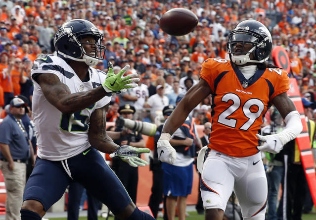 FILE - In this Sept. 9, 2018, file photo, Seattle Seahawks wide receiver Brandon Marshall, left, hauls in a touchdown pass in the end zone as Denver Broncos defensive back Bradley Roby (29) looks on during the second half of an NFL football game in Denver. One week after signing, then losing receiver Dez Bryant to an injury, the Saints welcomed another aging star, Brandon Marshall, to their receiver corps. (AP Photo/David Zalubowski, File)