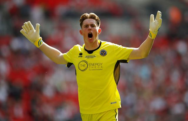 "Soccer Football - League One Play-Off Final - Rotherham United v Shrewsbury Town - Wembley Stadium, London, Britain - May 27, 2018 Shrewsbury Town's Dean Henderson celebrates their first goal scored by Alex Rodman Action Images/Carl Recine EDITORIAL USE ONLY. No use with unauthorized audio, video, data, fixture lists, club/league logos or ""live"" services. Online in-match use limited to 75 images, no video emulation. No use in betting, games or single club/league/player publications. Please contact your account representative for further details."