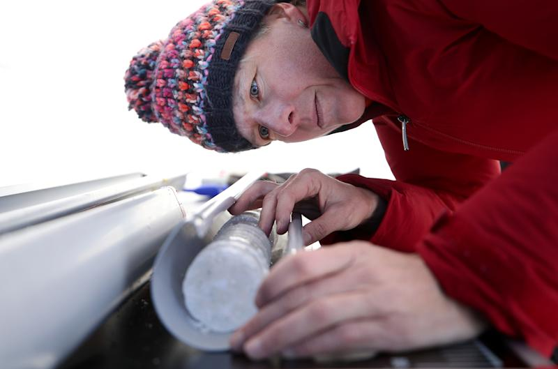 Glaciologist Andrea Fischer from the Austrian Institute for Interdisciplinary Mountain Research, examines an ice core of Gepatschferner glacier at Weissseespitze summit at over 3,500 meters above sea level, near Feichten im Kaunertal, Austria. (Photo: Lisi Niesner/Reuters)