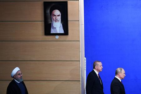 President Hassan Rouhani of Iran, Tayyip Erdogan of Turkey and Vladimir Putin of Russia arrive for a news conference following their meeting in Tehran, Iran September 7, 2018. Kirill Kudryavtsev/Pool via REUTERS