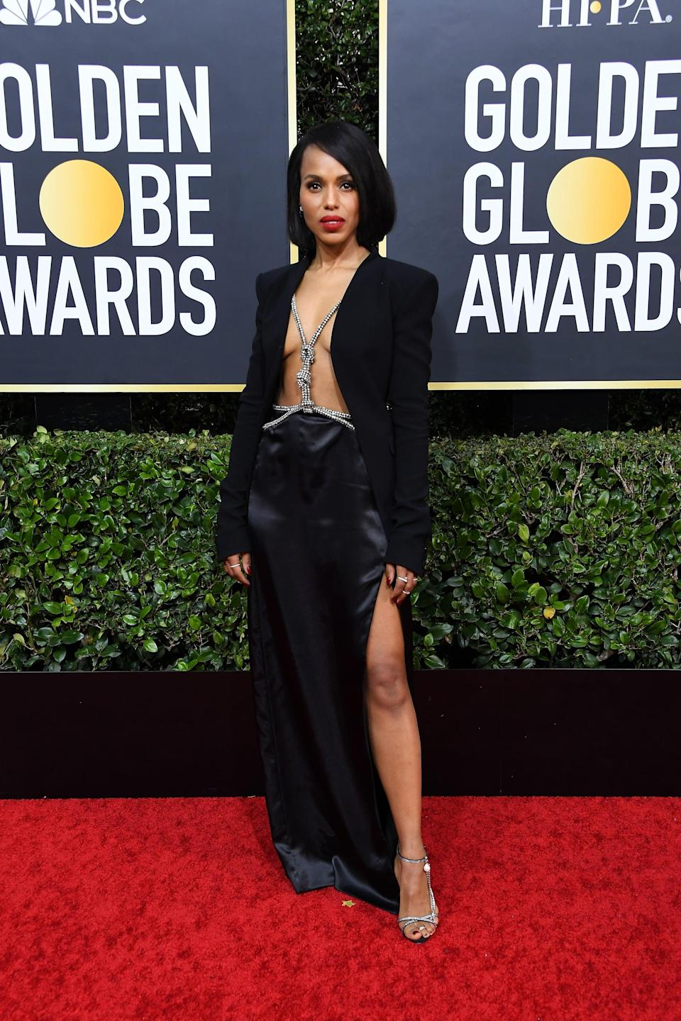 """<p><a class=""""link rapid-noclick-resp"""" href=""""https://www.popsugar.com/Kerry-Washington"""" rel=""""nofollow noopener"""" target=""""_blank"""" data-ylk=""""slk:Kerry Washington"""">Kerry Washington</a>'s Altuzarra look made quite the statement at the 2020 Golden Globes. The actress chose to go bra-less, accessorizing her sleek blazer with a thick body chain underneath, which hugged the waistline of her slitted silk skirt. Kerry, styled by Law Roach, finished the ensemble with striking Magda Butrym heels and Marli earrings.</p>"""