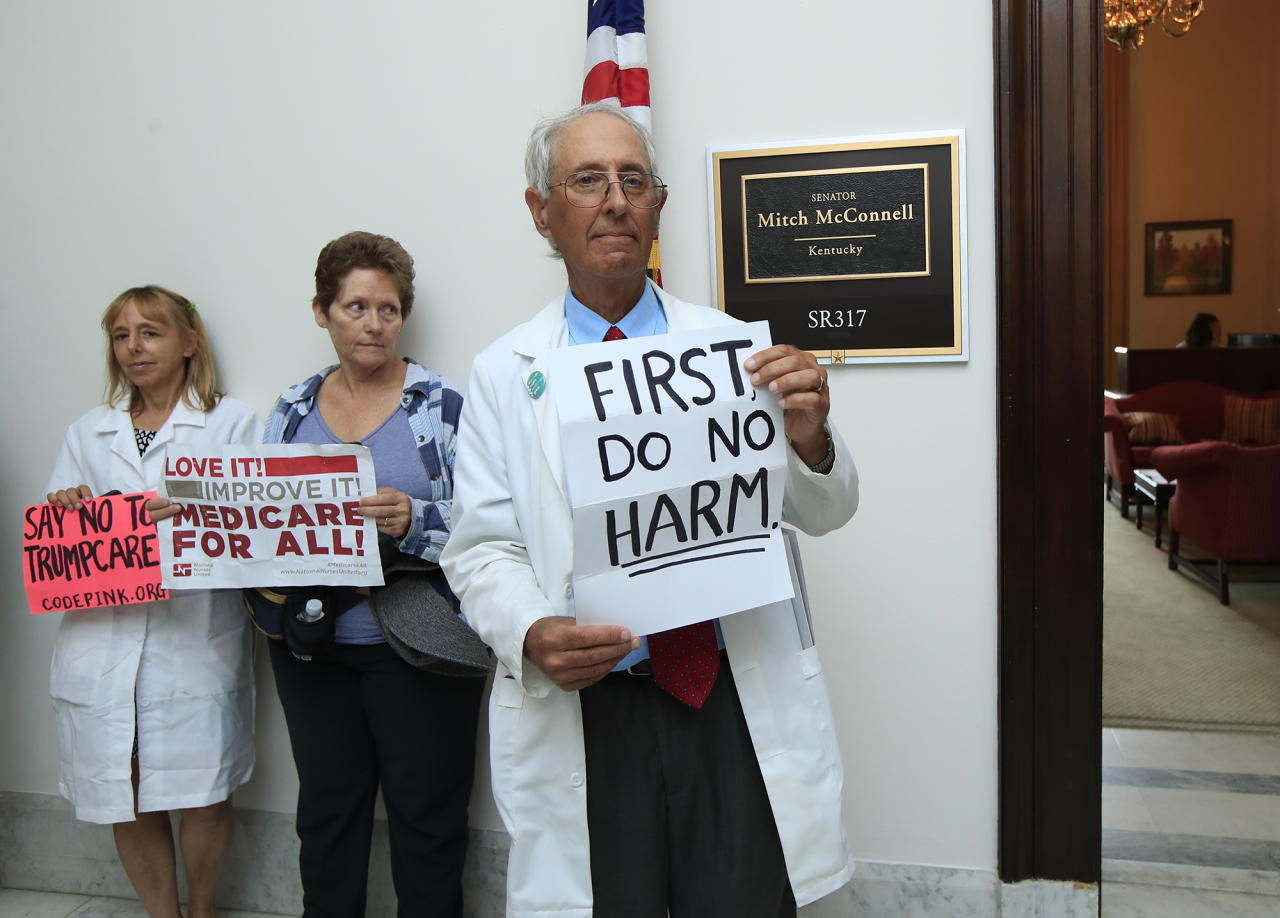 <p>Retired family physician Jay Brock of Fredericksburg, Va., joins other protesters against the Republican health care bill outside the office of Senate Majority Leader Mitch McConnell of Ky., Monday, July 17, 2017, on Capitol Hill in Washington. (Photo: Manuel Balce Ceneta/AP) </p>