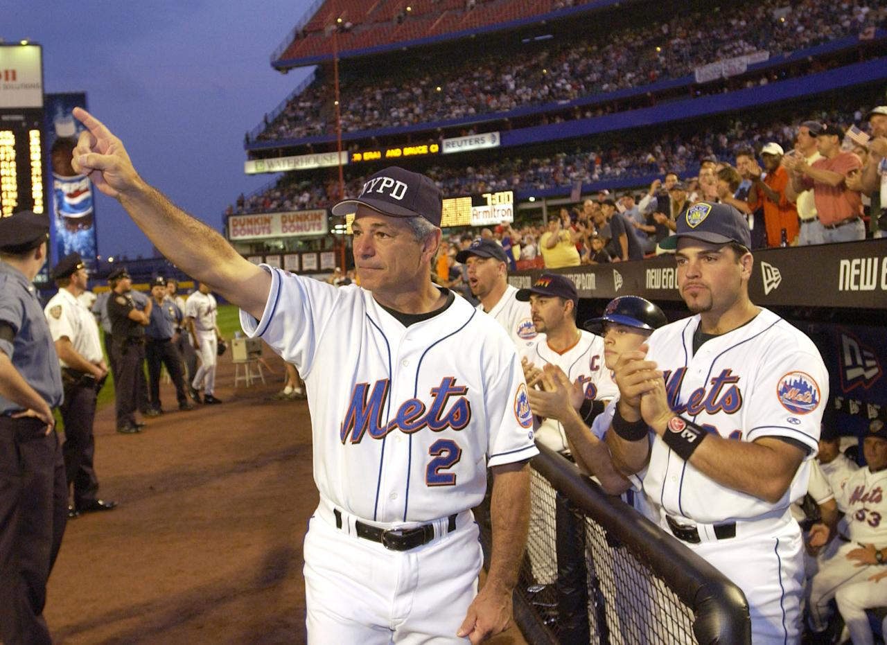 Manager Bobby Valentine and catcher Mike Piazza of the New York Mets applaude in honor of New York City Mayor Rudolph Giuliani before the Mets'' game against the Atlanta Braves at Shea Stadium in Flushing, NY September 21, 2001 in the first major sporting event in the New York area since the World Trade Center disaster. (Photo by Ezra Shaw/Allsport/Getty Images)