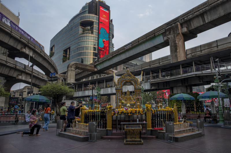 In this Feb. 4, 2020, photo, only a few devotees gather at Erawan shrine, usually congested with Chinese tourists in Bangkok, Thailand. The coronavirus outbreak that originated in China has battered the tourism industries of nations in Southeast Asia that have grown dependent on travelers from China, where rapidly growing incomes have led to a global tourism boom. (AP Photo/Gemunu Amarasinghe)