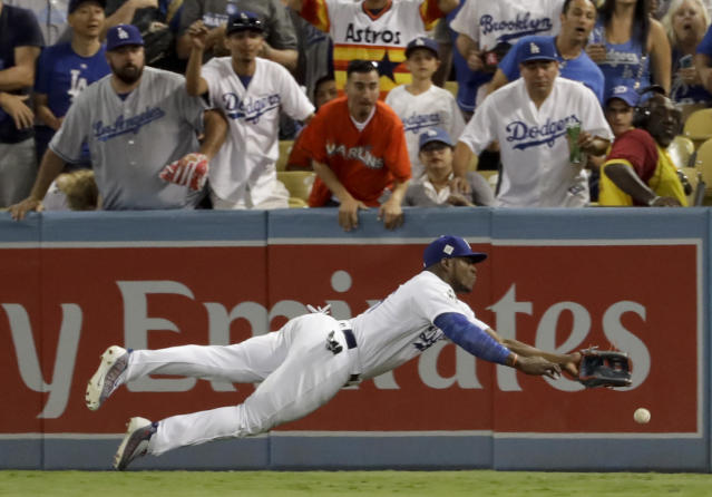 <p>Los Angeles Dodgers right fielder Yasiel Puig can't get a glove on a double by Houston Astros' Alex Bregman during the eighth inning of Game 2 of baseball's World Series Wednesday, Oct. 25, 2017, in Los Angeles. (AP Photo/Matt Slocum) </p>