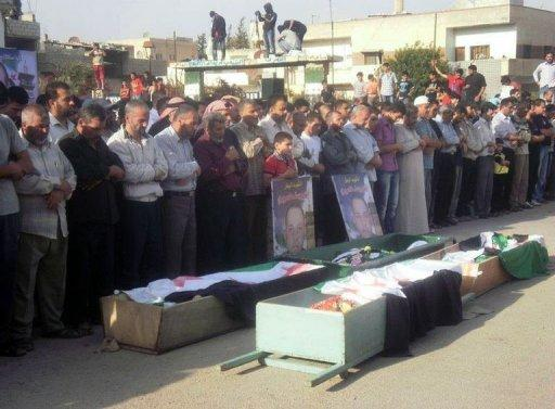 A handout image released by the Syrian opposition's Shaam News Network shows a funeral procession for people who were allegedly killed during unrest in the city of Daraa. AFP cannot independently verify this image. France says world powers could hold a summit on the Syrian crisis at the end of June as the deadly revolt against President Bashar al-Assad entered its 16th month