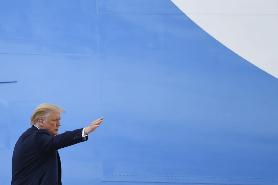 President Donald Trump waves from the top of the steps of Air Force One at Andrews Air Force Base in Md., Friday, July 10, 2020. Trump is heading to Florida to visit Southern Command, attend a roundtable event at a Doral church where he will speak with Cuban and Venezuelan dissidents and attend a fundraiser in Hillsboro Beach. (AP Photo/Susan Walsh)