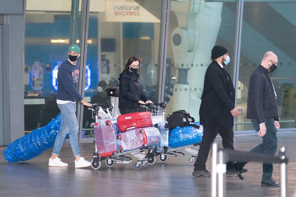 Passengers arrive at London Heathrow's Terminal 5 on the first flight to the airport from one of 33