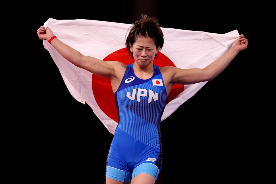 <p>Mayu Mukaida of Team Japan celebrates defeating Qianyu Pang of Team China during the Women's Freestyle 53kg Gold Medal Match on day fourteen of the Tokyo 2020 Olympic Games at Makuhari Messe Hall on August 06, 2021 in Chiba, Japan. (Photo by Ezra Shaw/Getty Images)</p>