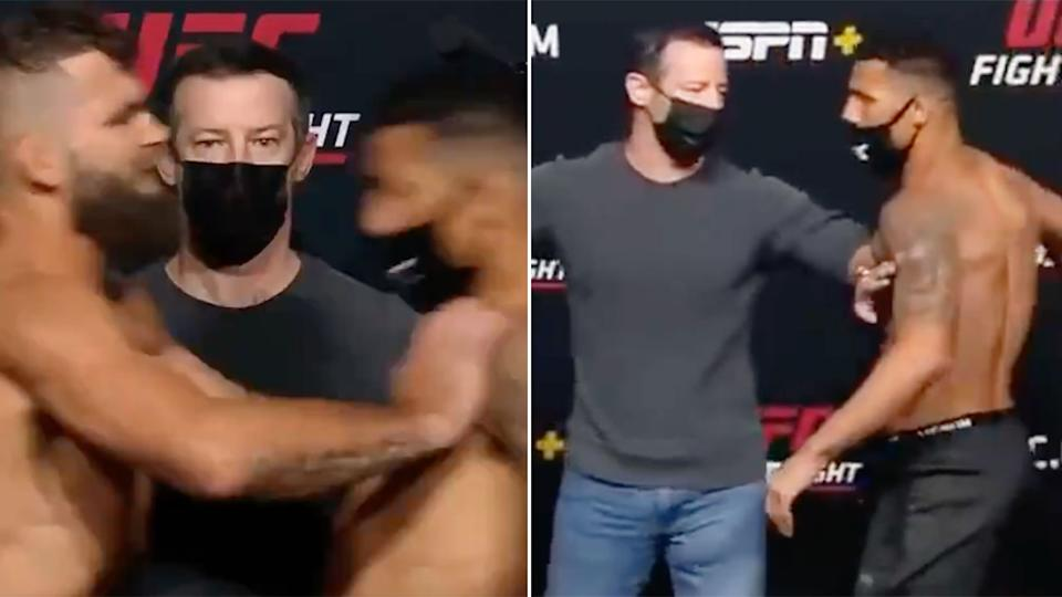 Seen here, Jeremy Stephens pushes UFC rival Drakkar Klose at weigh-in.