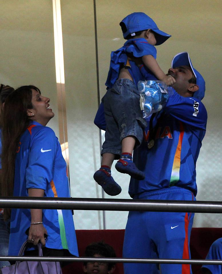 MUMBAI, INDIA - APRIL 2:  Indian cricketer Virendra Sehwag with his son and wife after India won the final of 2011 ICC World Cup beating Sri Lanka by 6 wickets at Wankhede stadium in Mumbai, India on April 2, 2011. (Photo by Santosh Harhare/Hindustan Times via Getty Images)