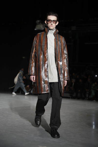 A model wears a creation as part of the Sunnei men's Fall-Winter 2020/21 collection, that was presented in Milan, Italy, Sunday, Jan. 12, 2020. (AP Photo/Luca Bruno)