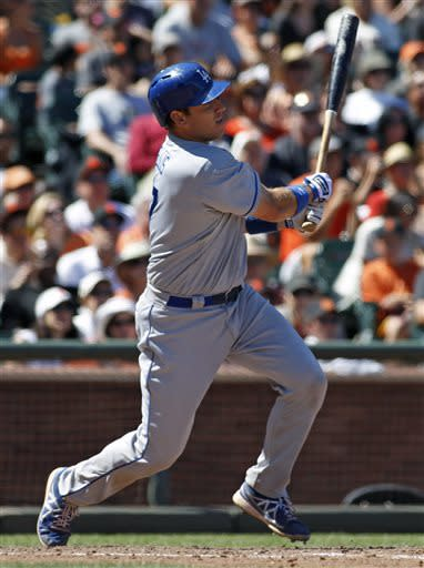 Los Angeles Dodgers' A.J. Ellis hits a three-RBI double against the San Francisco Giants during the ninth inning of a baseball game in San Francisco, Sunday, July 7, 2013. (AP Photo/George Nikitin)
