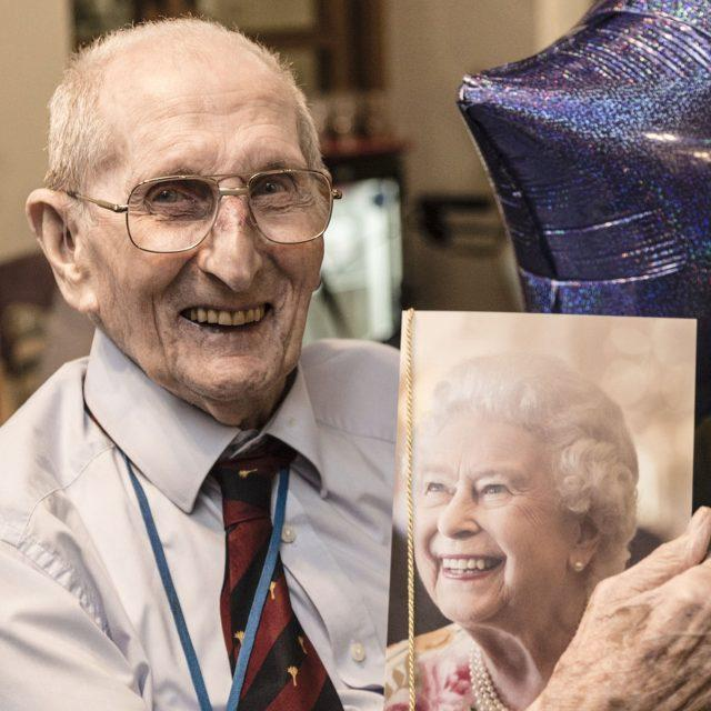 Charles Saunders with his birthday message from the Queen