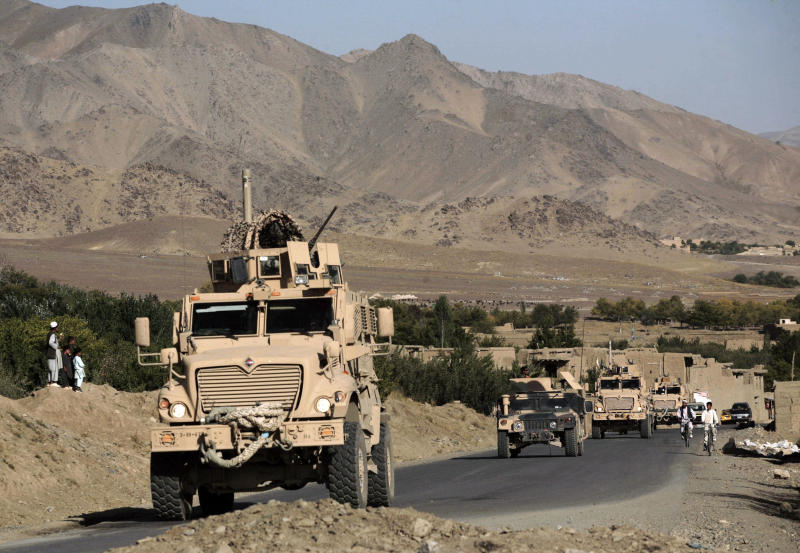 FILE- In this file photo taken Sept. 23, 2009, a column of U.S. Army mine-resistant armored vehicles (MRAPs) and Afghan National Army vehicles pass through a village during a joint patrol in the Jalrez Valley in Afghanistan's Wardak Province. As the United States military packs up to leave Afghanistan, ending 13 years of war, it is looking to sell or dispose of billions of dollars in military hardware, including its sophisticated and highly specialized mine resistant vehicles, but finding a buyer is complicated in a region where relations between neighboring countries are mired in suspicion and outright hostility.(AP Photo/Maya Alleruzzo, file)