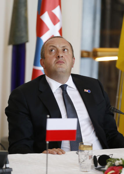 President of Georgia Giorgi Margvelashvili looks up during a press conference after a meeting on the 5th anniversary of the Eastern Partnership at the Prague Castle in Prague, Czech Republic, Friday, April 25, 2014. (AP Photo/Petr David Josek)