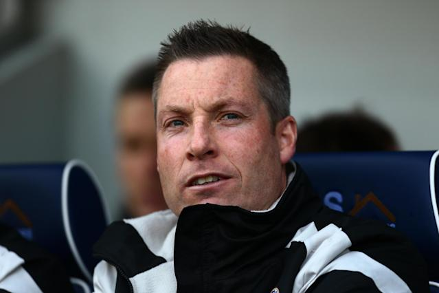 Millwall boss Neil Harris says club can thrive with their play-off rivals under pressure