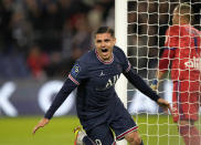 PSG's Mauro Icardi celebrates scoring his side's second goal during the French League One soccer match between Paris Saint-Germain and Lyon at the Parc des Princes in Paris Sunday, Sept. 19, 2021. (AP Photo/Francois Mori)