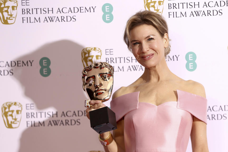 Actress Renee Zellweger poses with her award for Best Actress for Judy, backstage at the Bafta Film Awards, in central London, Sunday, Feb. 2, 2020. (Photo by Joel C Ryan/Invision/AP)