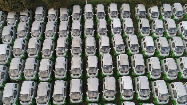 PHOTO: Aerial view of shared electric cars at a parking lot by the Qiantang River on March 23, 2019 in Hangzhou, China. (Xu Hui/Visual China Group via Getty Images)