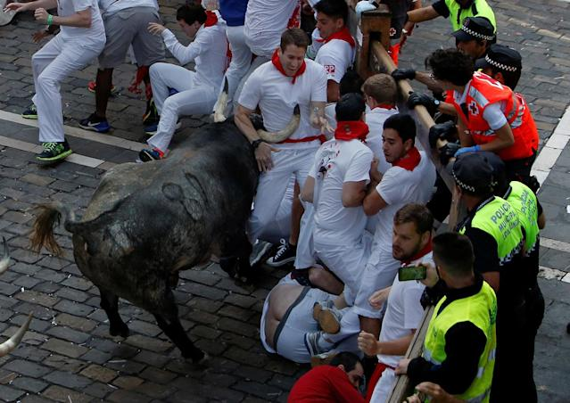 <p>A runner is trapped on the horns of a Cebada Gago bull during the first running of the bulls at the San Fermin festival in Pamplona, northern Spain, July 7, 2017. (Joseba Etxaburu/Reuters) </p>