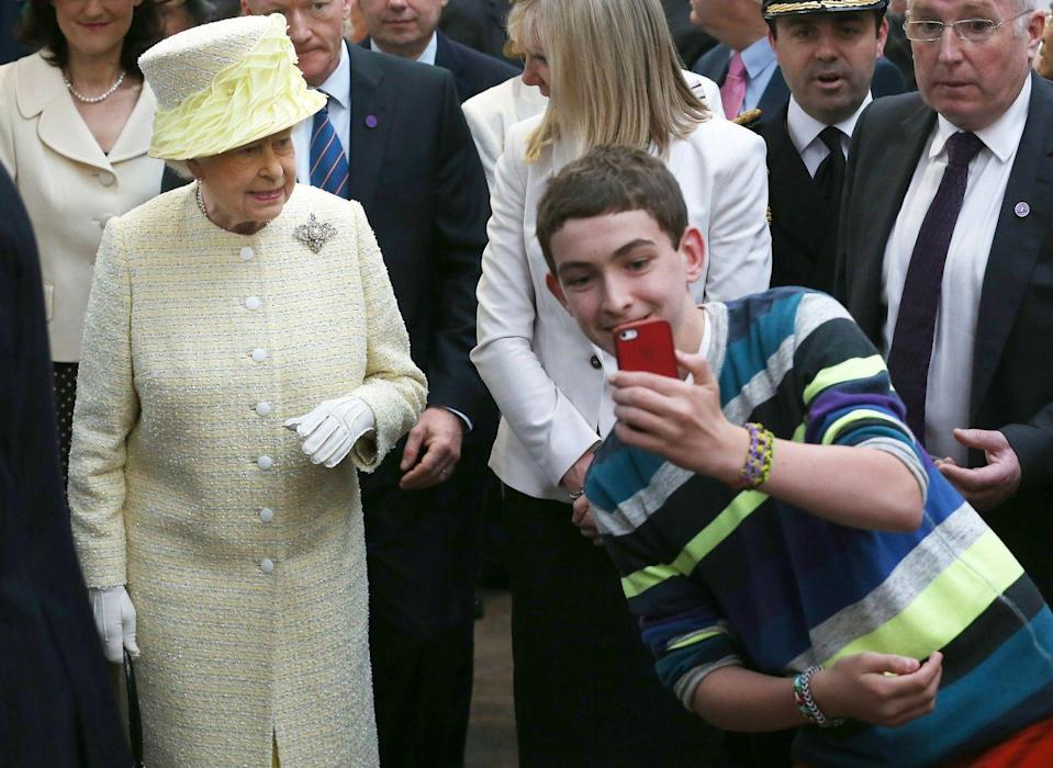 """<p>Selfies are seen as a <a href=""""https://www.news24.com/channel/Gossip/Royal-News/prince-william-breaks-royal-protocol-to-take-a-selfie-with-a-fan-20200305"""" rel=""""nofollow noopener"""" target=""""_blank"""" data-ylk=""""slk:breach in royal protocol"""" class=""""link rapid-noclick-resp"""">breach in royal protocol</a>, but that doesn't stop fans from taking them. Queen Elizabeth graciously joined the bandwagon of the digital trend, as she greets her fans in 2014.</p>"""