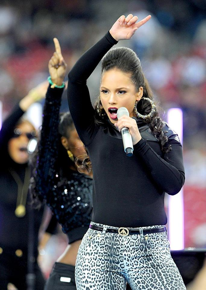"""Alicia Keys belts out a tune during the Super Bowl pre-game show while wearing a pair of wild leopard print pants and gigantic hoop earrings. Jeff Kravitz/<a href=""""http://filmmagic.com/"""" target=""""new"""">FilmMagic.com</a> - February 3, 2008"""