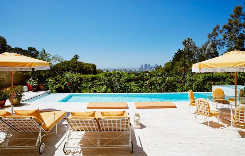 The backyard, featuring an infinity-edge saltwater pool, boasts prime views of Los Angeles. All the outdoor furniture is custom-made based on midcentury designs.
