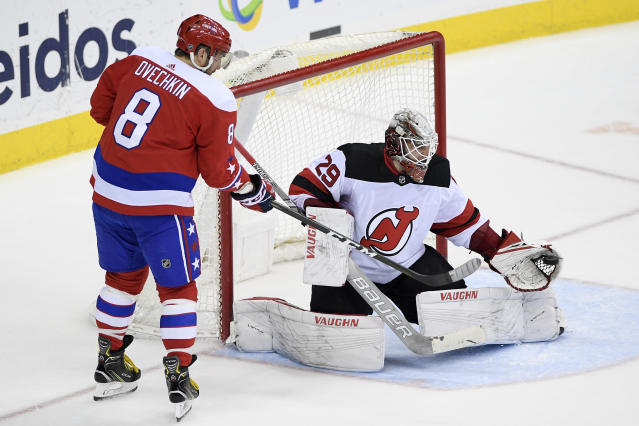 New Jersey Devils goaltender Mackenzie Blackwood (29) catches the puck next to Washington Capitals left wing Alex Ovechkin (8), of Russia, during the third period of an NHL hockey game Friday, March 8, 2019, in Washington. The Capitals won 3-0. (AP Photo/Nick Wass)