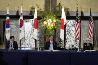 U.S. Deputy Secretary of State Wendy Sherman, right, South Korean First Vice Foreign Minister Choi Jong Kun, left, and Japanese Vice-Minister for Foreign Affairs Takeo Mori attend a press conference after their trilateral meeting at the Iikura Guesthouse Wednesday, July 21, 2021, in Tokyo. (AP Photo/Eugene Hoshiko)