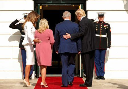 President Donald Trump (R) and first lady Melania Trump (L) greet Israeli Prime Minister Benjamin Netanyahu and his wife Sara as they arrive at the South Portico of the White House in Washington. REUTERS/Kevin Lamarque