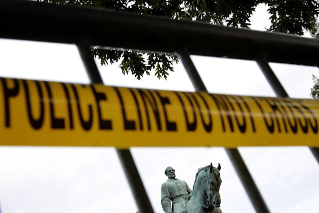<p>The statue of Confederat Gen. Robert E. Lee stands in the center of Emancipation Park the day after the Unite the Right rally devolved into violence August 13, 2017 in Charlottesville, Virginia. The Charlottesville City Council voted to remove the statue and change the name of the space from Lee Park to Emancipation Park, sparking protests from white nationalists, neo-Nazis, the Ku Klux Klan and members of the 'alt-right.' (Chip Somodevilla/Getty Images) </p>