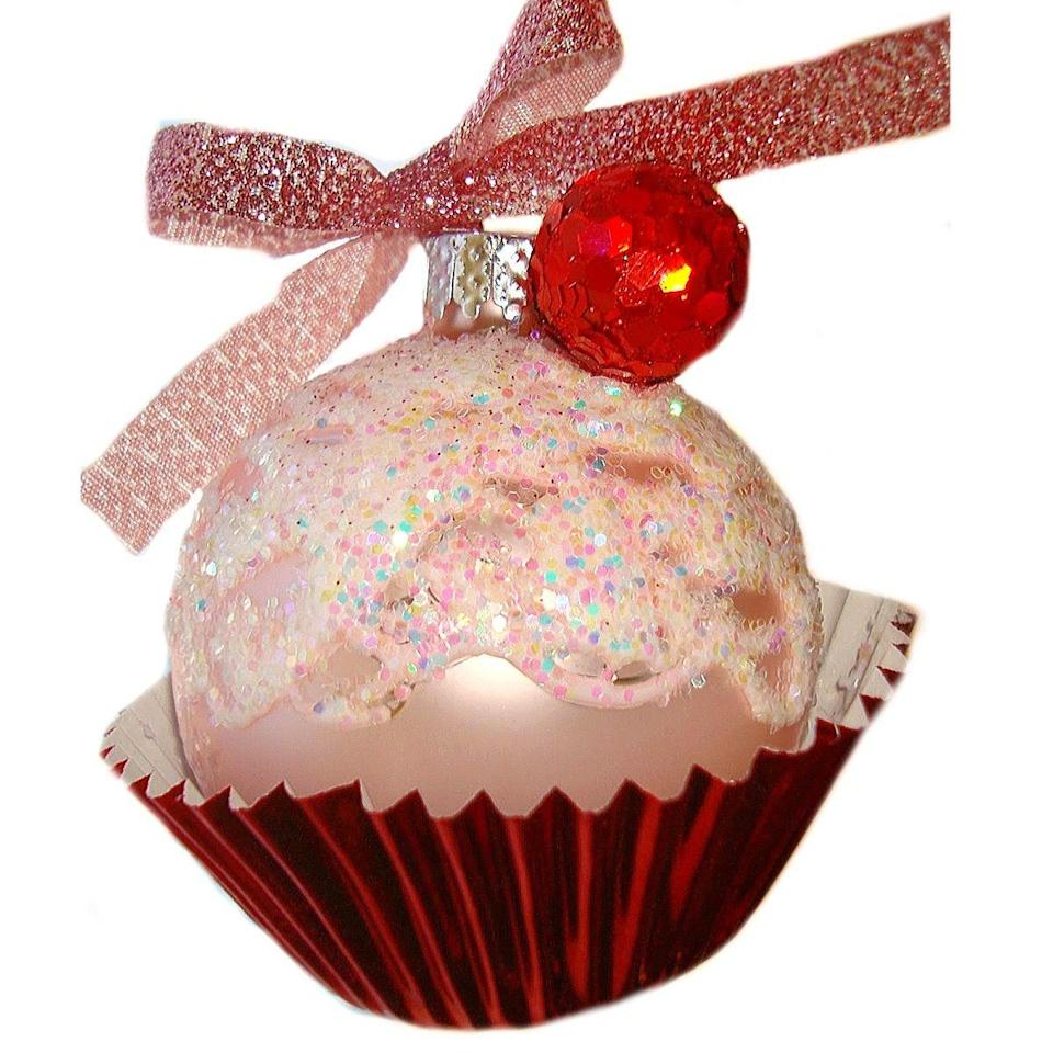 """<p>This adorable, glittery cupcake uses a foil cupcake liner as its base. Too cute!</p><p><strong>Get the tutorial at <a href=""""http://www.bentleyblonde.com/2012/11/cupcake-christmas-ornaments-diy.html"""" rel=""""nofollow noopener"""" target=""""_blank"""" data-ylk=""""slk:Bentley Blonde"""" class=""""link rapid-noclick-resp"""">Bentley Blonde</a>.</strong></p><p><a class=""""link rapid-noclick-resp"""" href=""""https://www.amazon.com/Warm-party-Baking-Cupcake-Standard/dp/B074L2XFQL/?tag=syn-yahoo-20&ascsubtag=%5Bartid%7C10050.g.28831556%5Bsrc%7Cyahoo-us"""" rel=""""nofollow noopener"""" target=""""_blank"""" data-ylk=""""slk:SHOP CUPCAKE LINERS"""">SHOP CUPCAKE LINERS</a></p>"""