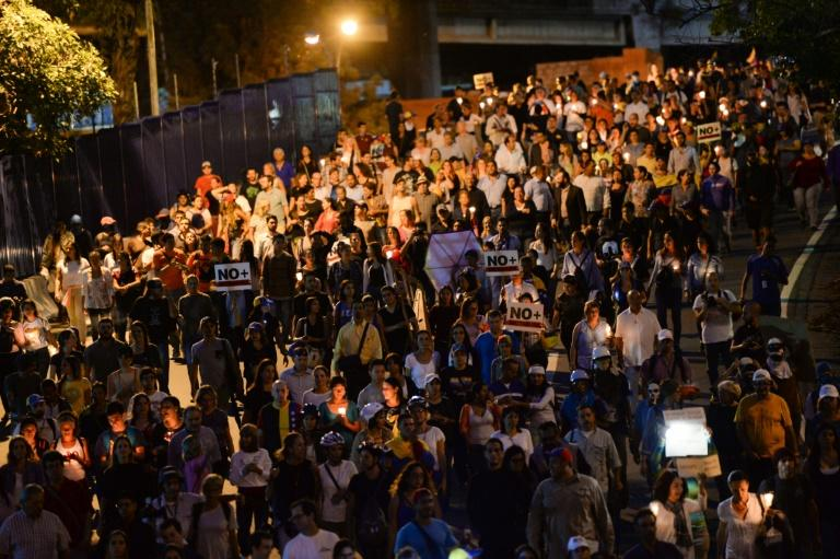 Opposition demonstrators march towards OAS headquarters in Caracas  after the OAS General Assembly rules out issuing a resolution on the crisis in Venezuela