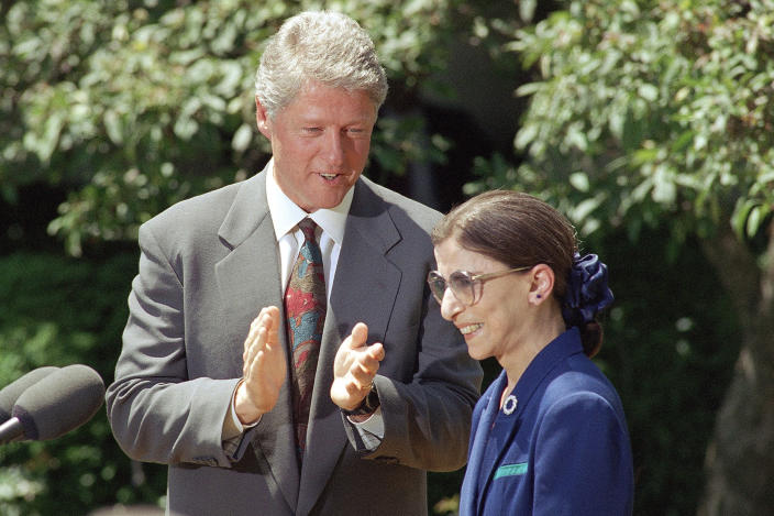 FILE - In this June 15, 1993, file photo, President Bill Clinton applauds as Judge Ruth Bader Ginsburg prepares to speak in the Rose Garden of the White House,after the president announced he would nominate Ginsburg to the Supreme Court. Ginsburg, 60, a federal appeals judge, will fill the vacancy left by the retirement of Justice Byron White. Ginsburg, a diminutive yet towering women's rights champion who became the court's second female justice, has died at her home in Washington. (AP Photo/Doug Mills, File)