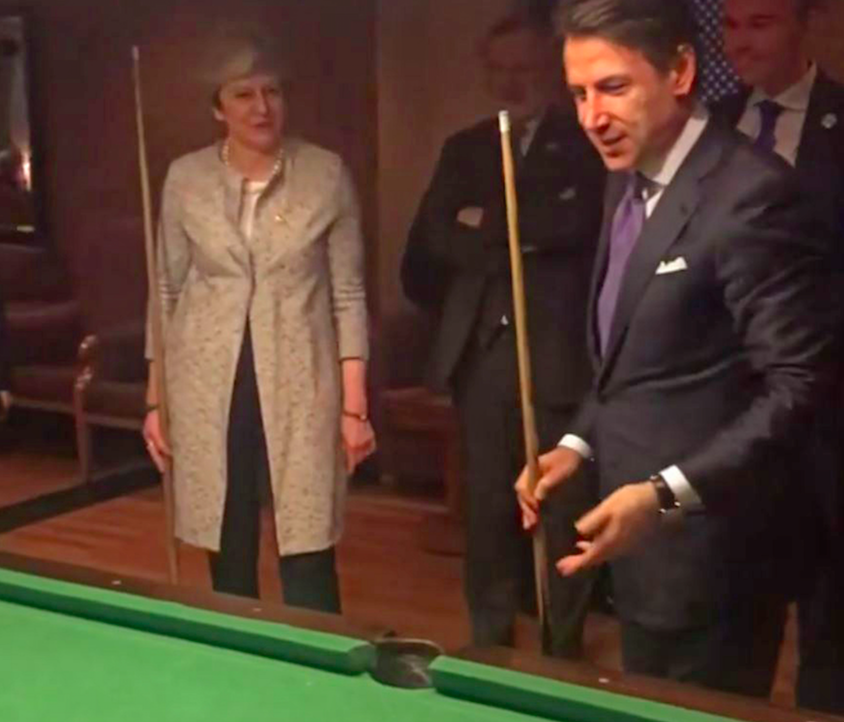 Theresa May takes cue from Italian counterpart around pool table